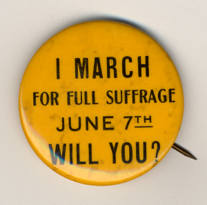 "Yellow political button with dark text that says ""June 7th, I march for full suffrage will you?"""