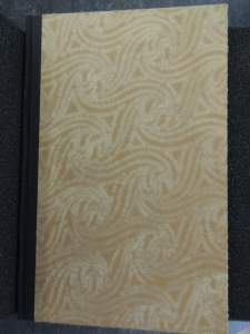 Cover of book showing a textured paper with a repeated design of geometric curves.