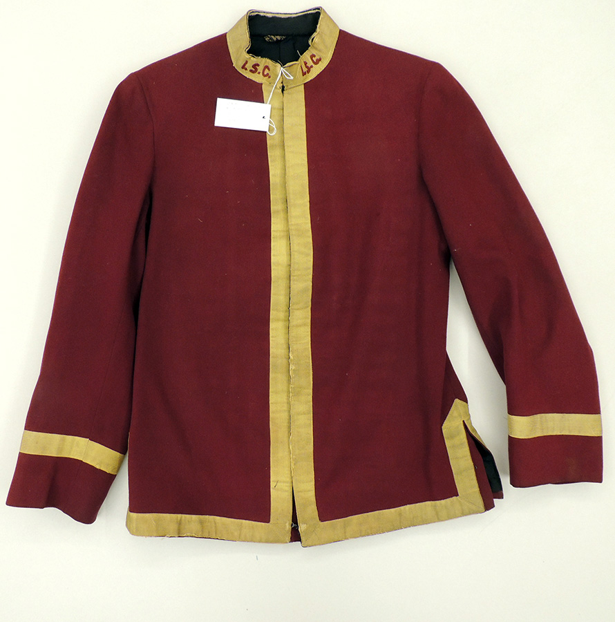 "is maroon wool jacket with gold collar, trim, and stripe on sleeve. Embroidery on collar spells ""I.S.C."" in maroon thread."