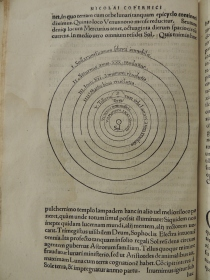 Page showing a diagram of the heliocentric solar system model from Copernicus's De Revolutionibus.