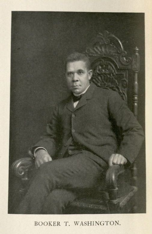 Portrait of man sitting in a wooden chair.
