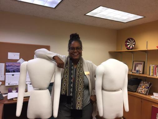 Petrina triumphant after putting together our new mannequins, she had some help! (Photo by Rachel Seale).