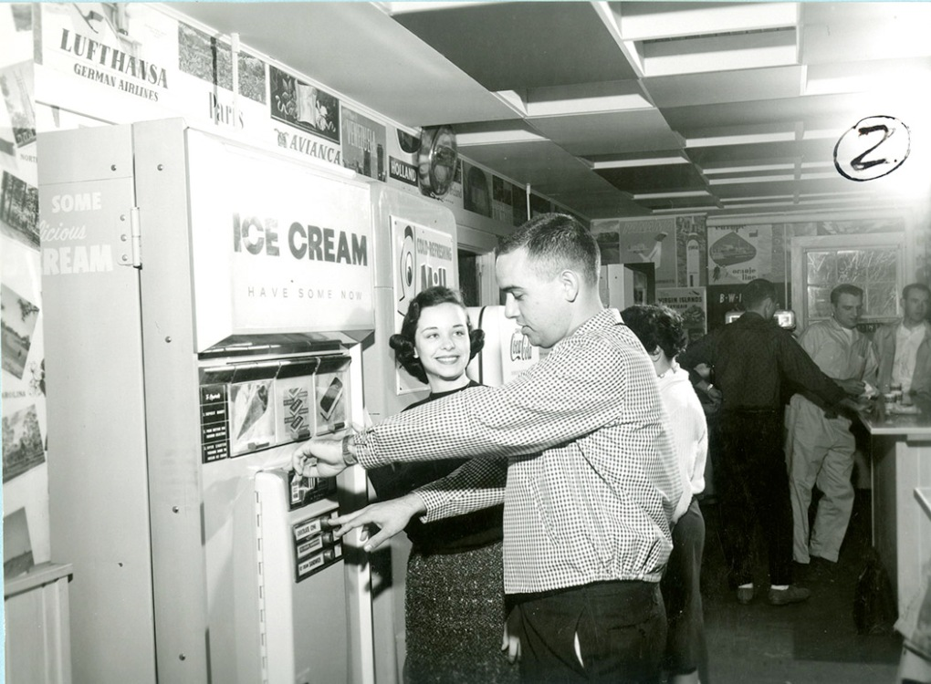 Student getting an ice cream treat from a vending machine in the Hub in 1960.