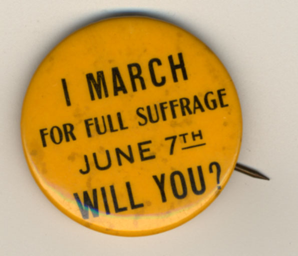 """Photograph of a political button reading, """"I march for full suffrage June 7th. Will you?"""" From the SCUA Artifact Collection. Suffragists wore buttons like this for a variety of reasons.  Many to get people to know that suffrage was on the ballot or to proudly show that they were a suffragist."""