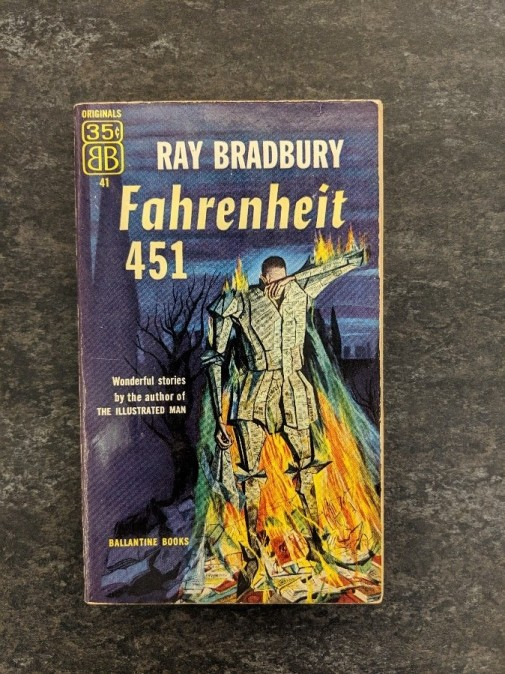Fahrenheit 451 by Ray Bradbury is housed in a special box to keep it safe, but look at this cover art! In the top left hand corner of the cover, you can see that the book was originally $.35!