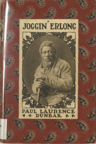 Cloth bound book in red cloth with black-and-white paisley design and a printed photographic portait of a Black man surrounded by the book's title and author's name.