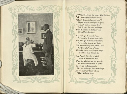 "Left page shows a black and white photograph of a white woman seated at a piano looking up at a standing African American man wearing a suit and looking calmly down on the woman. On the right page are the first three stanzas of the poem, ""When Malindy Sings."""