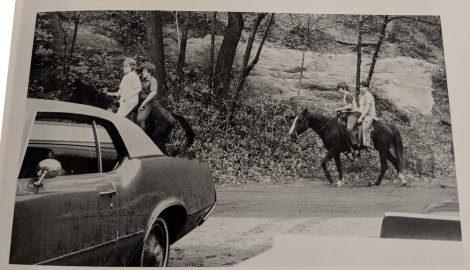 Four students riding two horses together through Ledges State Park.