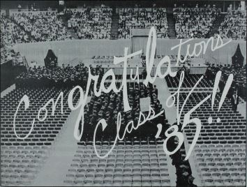 "page from 1985 Bomb, ISU's yearbook, black-and-white image of commencement and white text in cursive reads ""Congratulations Class of '85!!"" over image."