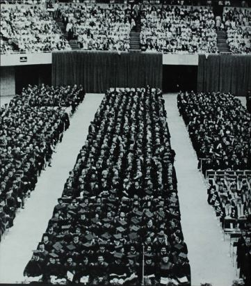 Black and white photo of students sitting during graduation ceremony in 1985