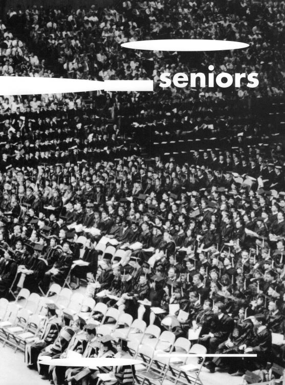 Black and white photo of students sitting during graduation ceremony in 1994