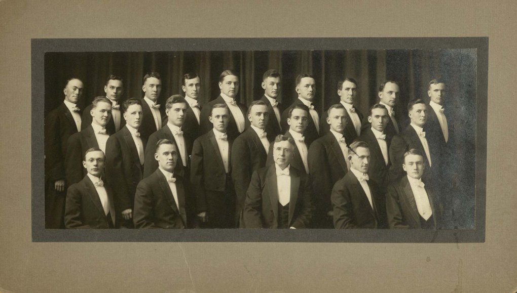 Group portrait of class of 1914, all students wearing tuxedos.