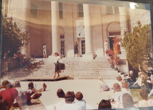 Model in black skirt posing for the crowd.