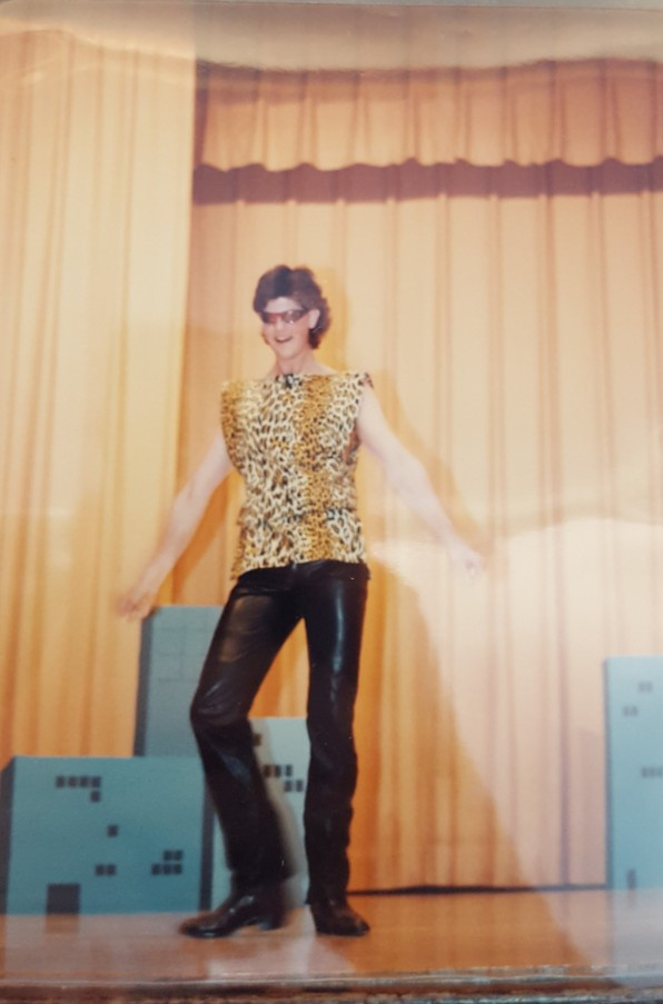 Male student in cheetah print vest and leather pants.