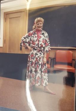 Model in flower print dress.