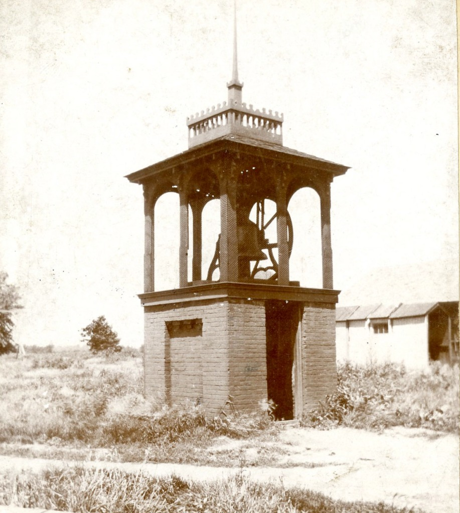 Photo of the College Bell in its housing. This would have been located to the west of the Main Building.