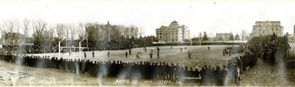 Panoramic photo of the Athletic field during the November 23, 1907 Iowa State-Iowa game. Fans surrounding the field and in the background you can see Morrill Hall, The Hub, Beardshear Hall, Alumni All and Marston Hall.