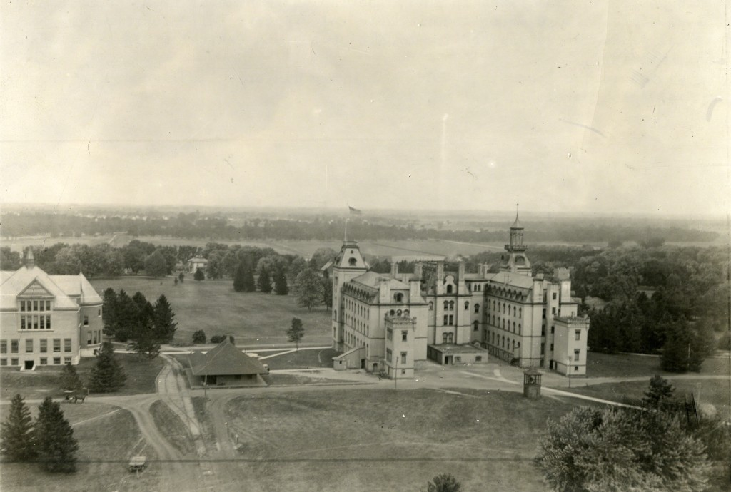 """This photograph was taken in 1897, looking southeast from the balcony of Iowa State College water tower. Note the """"Victory Bell"""" location, a material distance due west of the middle of the Old Main.  University Photograph Collection, RS 4-8-I Box 209."""