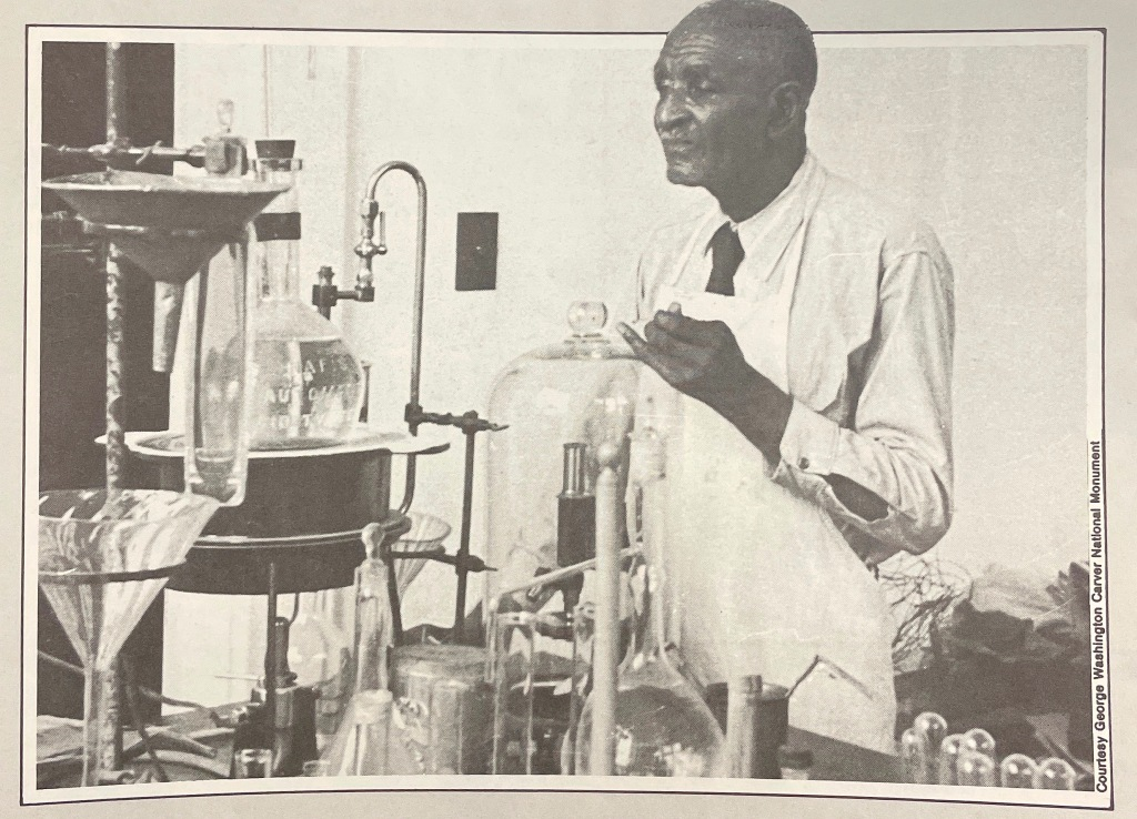 News paper clipping picture of George Washington Carver in a science lab